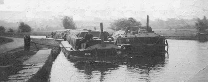 11 Thomas Murphy Junior on bow of 40M with 71M at Lowtown c 1950s © Conroy Collection