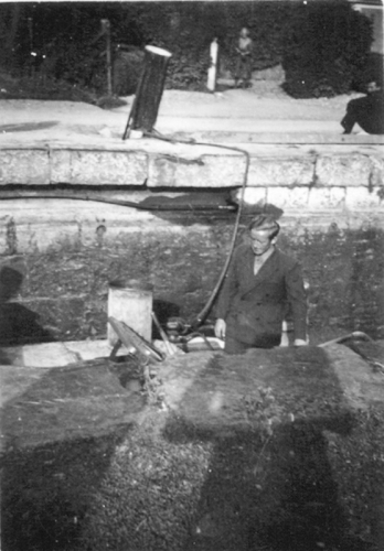 12 M Boat descending in Lowtown Lock c 1950s © Conroy Collection