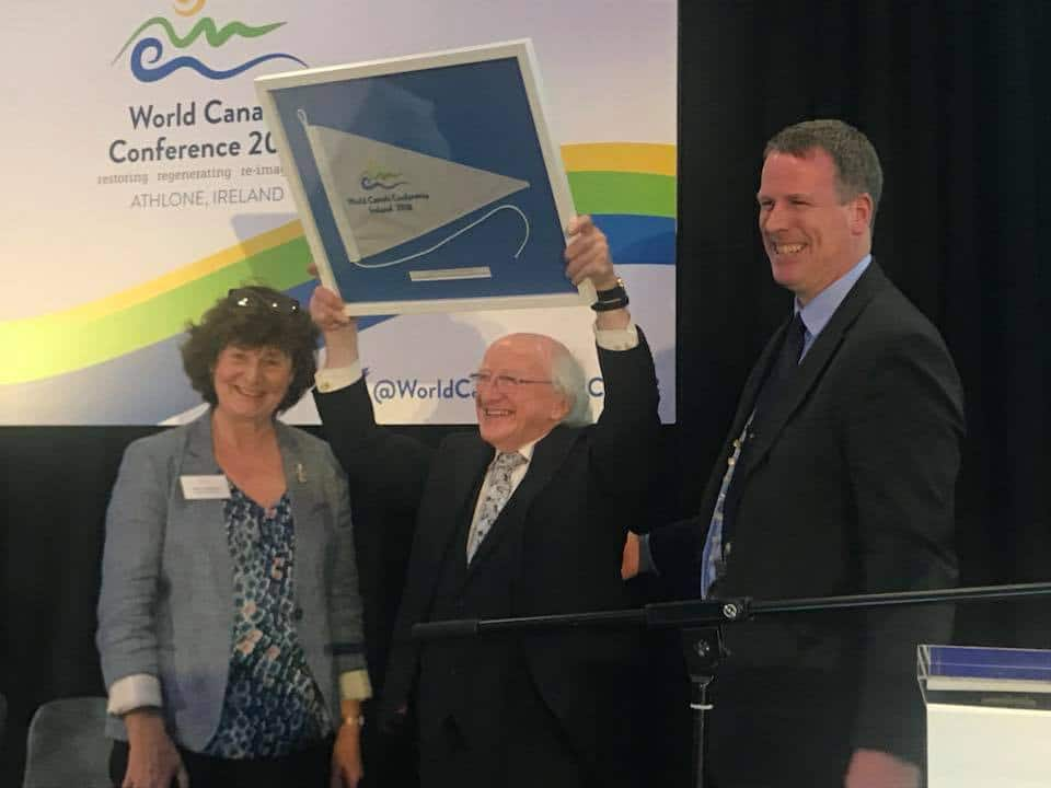 Dawn liningstone Waterways Ireland , John dolan president IWAI , presents framed purgee to President Higgins